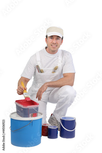 Painter getting ready to paint a wall