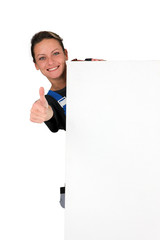 Woman behind white panel