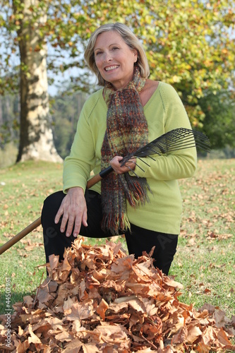 Landscape picture of woman picking up litter