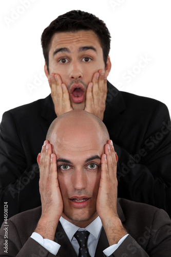 Two horrified businessmen