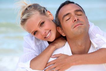 Loving couple hugging on the beach