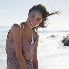 Portrait of smiling woman on sunny beach