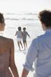 Family on sunny beach