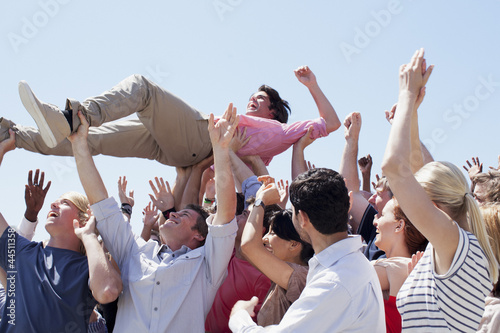 Man crowd surfing