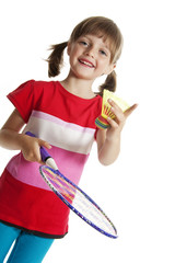 little girl playing badminton game