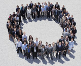 Portrait of smiling business people forming circle