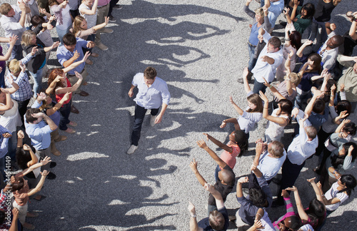 Man walking through cheering crowd