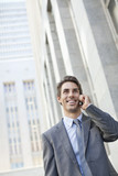 Smiling businessman talking on cell phone