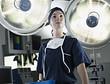 Portrait of confident nurse under surgical lights