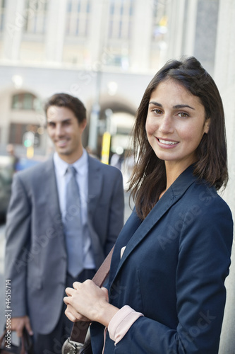 Portrait of smiling businesswoman on urban street