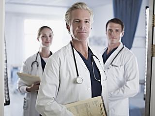 Portrait of confident doctors in hospital room