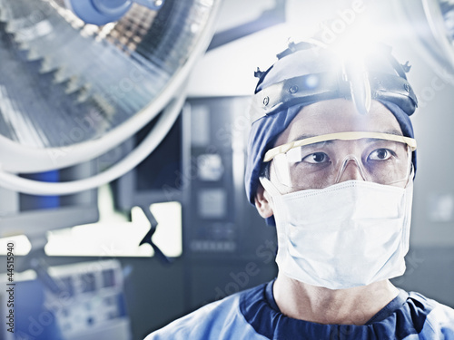 Close up of surgeon wearing headlamp