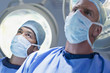 Serious surgeons under surgical lights