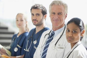 Portrait of smiling doctors and nurses in a row