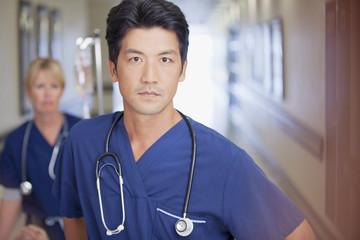Portrait of serious nurse in hospital corridor