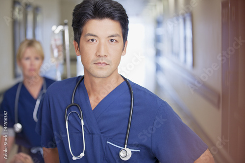 Portrait of serious nurse in hospital corridor