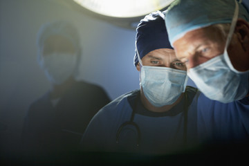 Close up of focused surgeons working in operating room