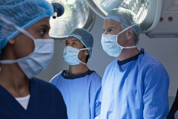 Surgeons working in operating room