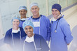 Portrait of smiling surgeons and nurses in hospital corridor