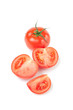Vertical shot of a whole ripe tomato and its slices on white