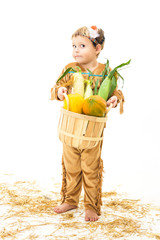 adorable Native American child holding a basket of food.