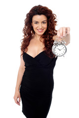 Beautiful woman posing with a timepiece