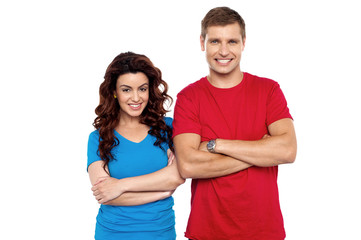 Attractive couple posing with arms crossed