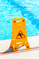"Sign ""slippery floor"" by the pool"