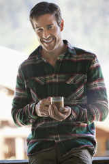Portrait of smiling man drinking coffee