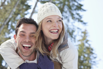 Portrait of smiling couple piggybacking