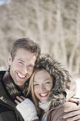Portrait of smiling couple hugging outdoors