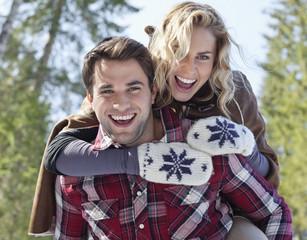 Portrait of smiling couple piggybacking