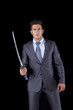 Businessman holding a ninja sword
