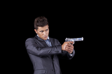 Businessman holding a handgun