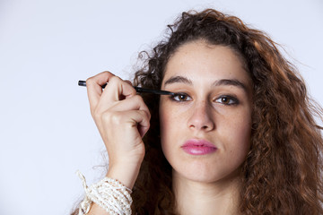 Woman applying the eyeliner