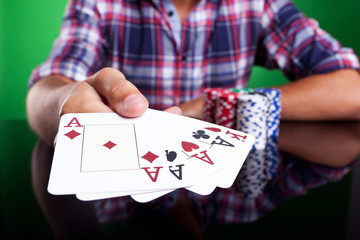 Cropped image of a winning four aces poker hand