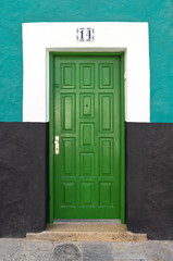 Green door of the typical villas in Gran Canaria