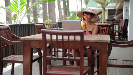 Asian freelance business woman at cafe with laptop and phone