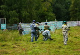 Paintball players go into battle