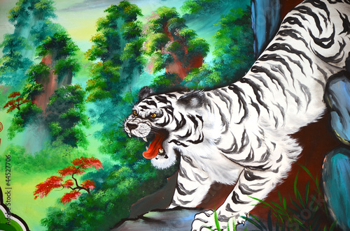 White tiger painting on stone wall.
