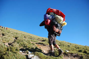 Climbing guy walking on the mountain