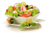 Fototapety Vegetable salad bowl isolated on white