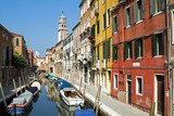 Canal and beautiful sunlit buildings in Venice.