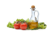 Tomato, lettuce salad and jug of vegetable oil oil isolated
