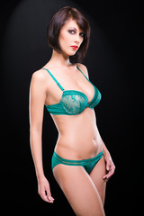 young woman in elegant green lacy underwear