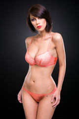 young woman in elegant pink lacy underwear