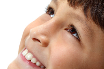 Close-up of young boy's eyes smiling