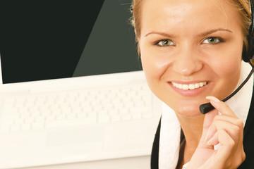 Close-up portrait of friendly secretary/telephone operator.