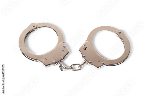 metal handcuffs isolated on white