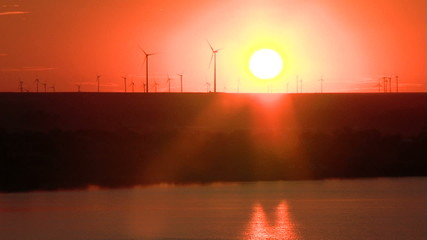 Wind turbines at sunset timelapse